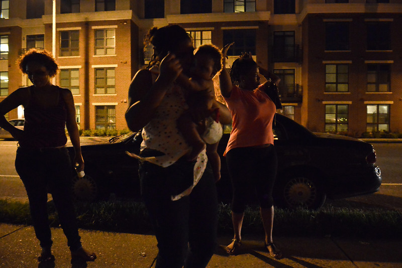 An evening outside with friends and family. Caressa's daughter dances with her little brother.