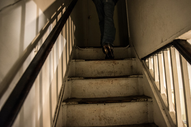 Mike Davis climbs the steps of his dilapidated rental house in Old Town Alexandria.