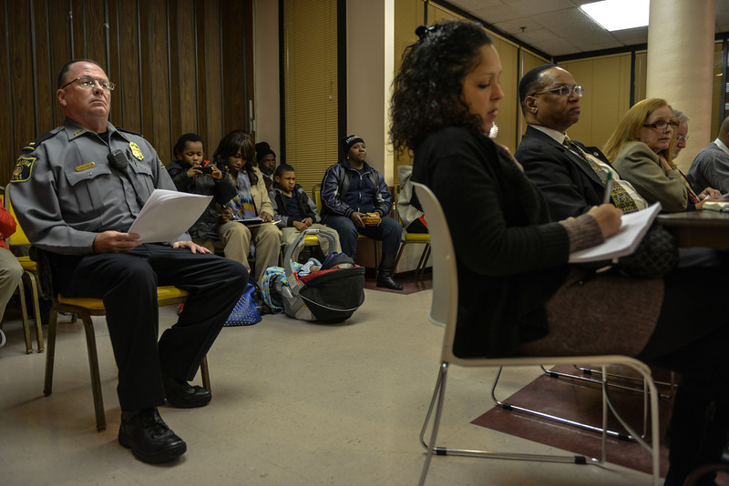 Nisaa and her children at a community meeting on Alexandria's public housing.