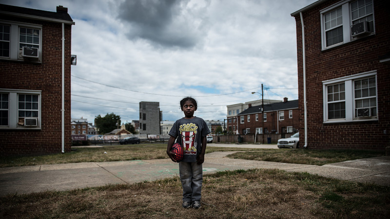 Lead shot for project.  Malik, a young boy from the housing projects in Alexandria, poses for a photograph in October 2013. The housing project in which he lives is due to be razed in 2015 to make way for luxury condominiums and town homes.