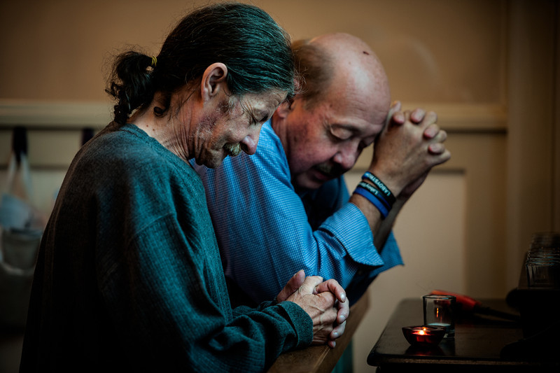 Mike Davis and Wayne Hulehan pray together at Commonwealth Baptist Church in Rosemont. Davis serves as a deacon in the church.