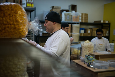 Rich Arslan, owner of gourmet popcorn's Popped Republic, checks his inventory before stocking up the food truck for the day.