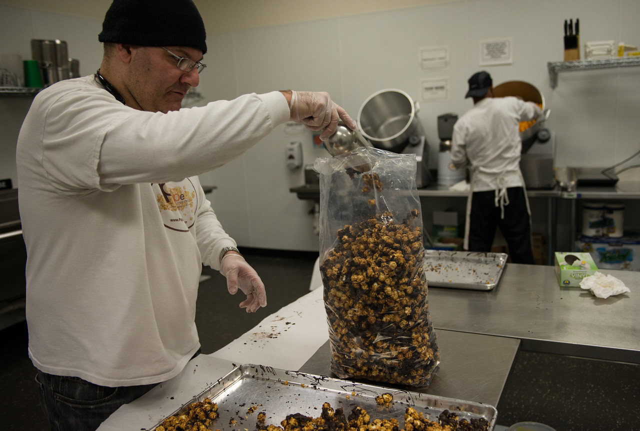 Rich Arslan, owner of gourmet popcorn's Popped Republic, bags the Dark Chocolate-Drizzled Capitol Caramel.