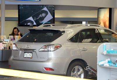 SUV DRIVES INTO BEAUTY STORE