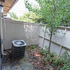 Side patio by air conditioner