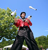 HOLLY PELCZYNSKI - BENNINGTON BANNER Joshua J. Superstar Edemian throws juggling clubs into the air during the Southwestern Vermont Medical Center's 100th birthday and Community Day celebration on Sunday afternoon in Bennington.