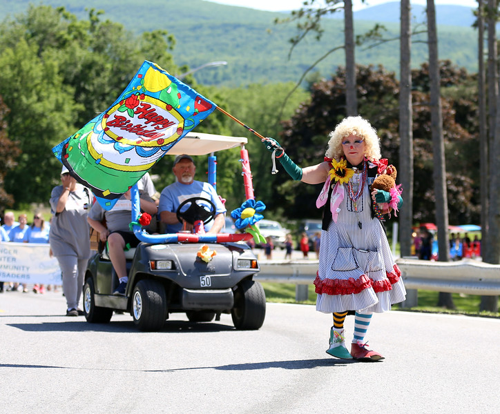 """HOLLY PELCZYNSKI - BENNINGTON BANNER """"Cleo the clown"""" dances and waves a Happy Birthday flag while marching in the Community Day held by Southwestern Vermont Medical Center on Sunday in Bennington."""