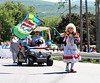 "HOLLY PELCZYNSKI - BENNINGTON BANNER ""Cleo the clown"" dances and waves a Happy Birthday flag while marching in the Community Day held by Southwestern Vermont Medical Center on Sunday in Bennington."
