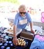 HOLLY PELCZYNSKI - BENNINGTON BANNER Leone Dusaboln stocks some cupcakes for sale during the Cancer Center Community Crusaders Cupcake Challenge on Sunday during the  Southwestern Vermont Medical Center's 100th birthday and Community Day celebration.
