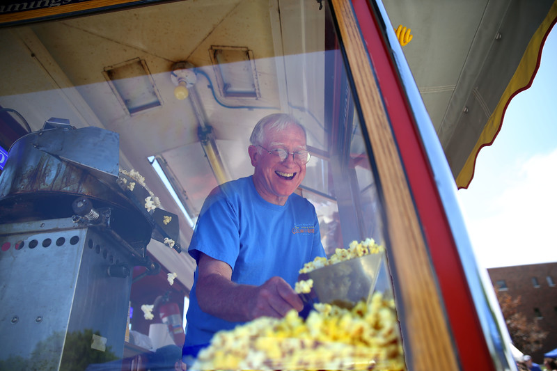 HOLLY PELCZYNSKI - BENNINGTON BANNER Skip Reed, of Hemming's Motor News serves up some popcorn to visitors during the Southwestern Vermont Medical Center's 100th birthday and Community Day on Sunday in Bennington.