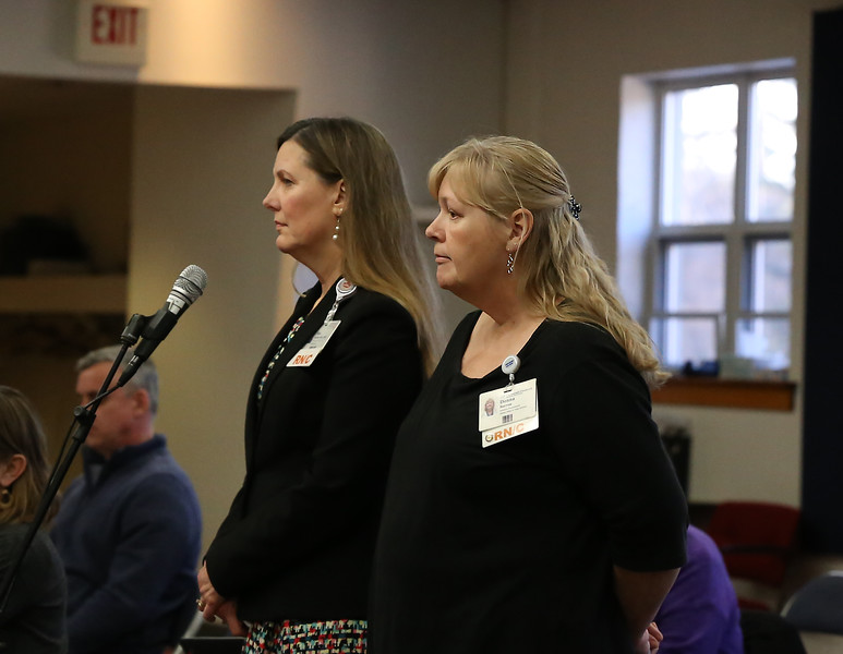 HOLLY PELCZYNSKI - BENNINGTON BANNER Southwestern Vermont Medical Center's Registered Nurses Donna Barron and Pamela Duchene settle the nerves of concerned citizens and members of the select board while answering their questions concerning the corona virus, during the select board meeting on Monday at the Bennington Fire House.