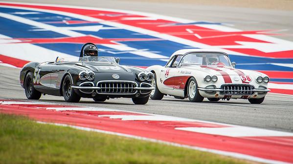 Two 1958 Corvettes headed into turn 19 braking zone.