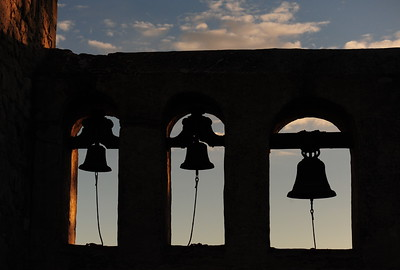 Three bells representing three crosses.