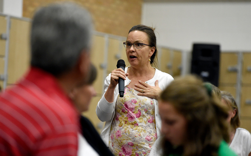 . Niwot High School english teacher Angie Roberts voices her concerns on a proposal to keep a rifle in a safe at Niwot High School during a meeting at Sunset Middle School in Longmont on Thursday. The meeting was in regards to a proposal to keep a rifle in a safe at Niwot High School for police in case of a school shooting scenerio. Jeremy Papasso/ Staff Photographer 06/07/2018