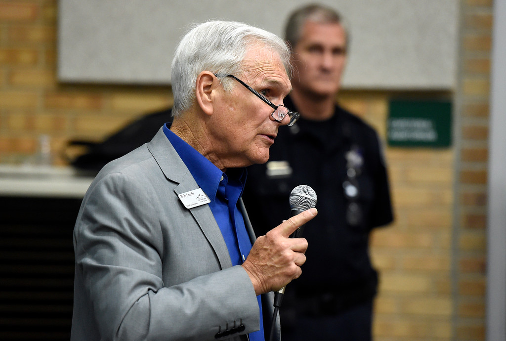 . Bob Smith, president of the St. Vrain Valley School District Board of Education, talks about a proposal to keep a rifle in a safe at Niwot High School during a meeting at Sunset Middle School in Longmont on Thursday. The meeting was in regards to a proposal to keep a rifle in a safe at Niwot High School for police in case of a school shooting scenerio. Jeremy Papasso/ Staff Photographer 06/07/2018