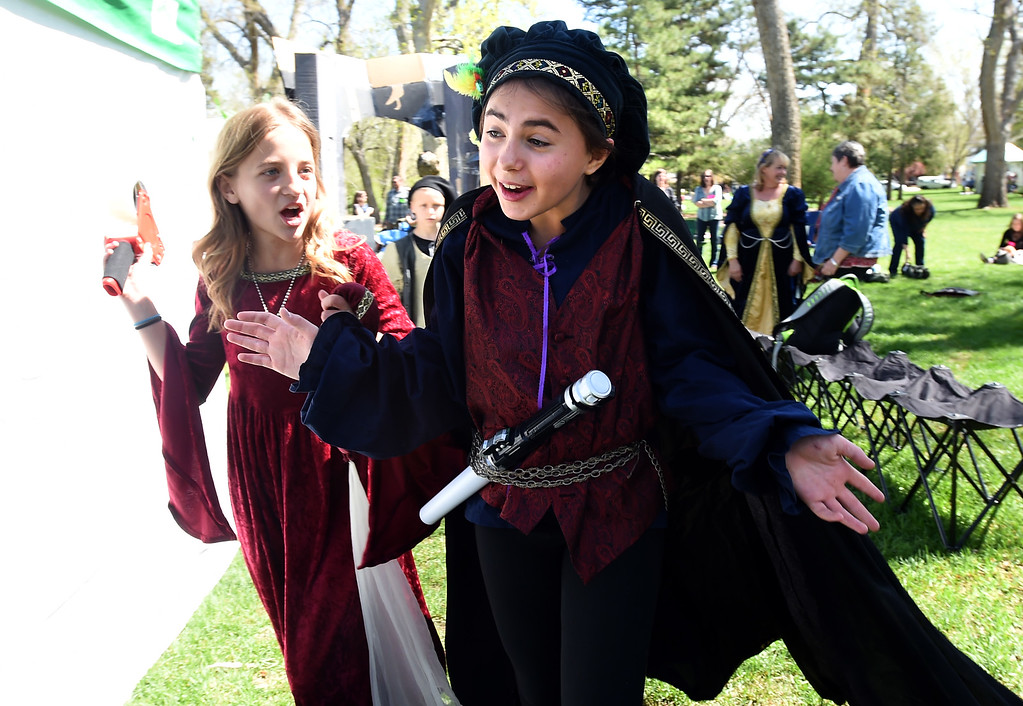 ". Riley Anfrews, left, and Julia Norton, both of Burlington Elementary. rush to the stage to do ""Hamlet.\"" The annual Shakespeare in the Park Festival was held in Longmont on Friday.  Fifth-graders from across the district performed self directed/produced Shakespeare productions. It is organized by St. Vrain\'s Gifted and Talented Program. For more photos and a video, go to dailycamera.com. Cliff Grassmick  Photographer  May 4,  2018"