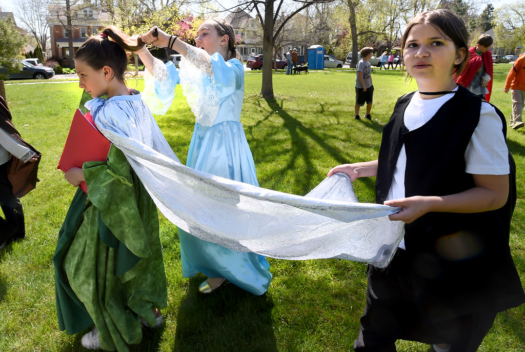 ". Sydney Maddaloni, Norma Ritty, and Riley Valania, of Black Rock Elementary, walk over to their stage to do ""Macbeth.\""The annual Shakespeare in the Park Festival was held in Longmont on Friday.  Fifth-graders from across the district performed self directed/produced Shakespeare productions. It is organized by St. Vrain\'s Gifted and Talented Program. For more photos and a video, go to dailycamera.com. Cliff Grassmick  Photographer  May 4,  2018"