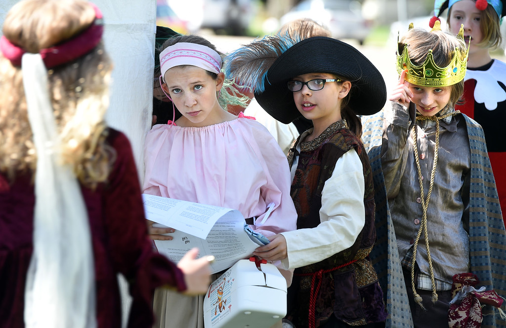 ". Brigit Deswarte, left,  and Lia Oldroyd, wait to go onstage for ""Twelfth Night.\""The annual Shakespeare in the Park Festival was held in Longmont on Friday.  Fifth-graders from across the district performed self directed/produced Shakespeare productions. It is organized by St. Vrain\'s Gifted and Talented Program. For more photos and a video, go to dailycamera.com. Cliff Grassmick  Photographer  May 4,  2018"