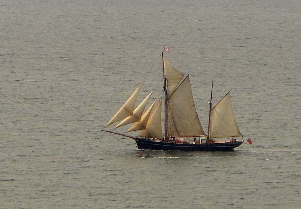 A Gaff Ketch, fully rigged and all sail aloft, running before the wind, and by the look of it being filmed from the RIB alongside.   Photo taken from Gribbin Head.
