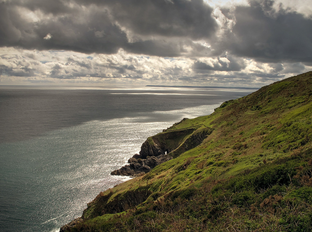 Some afternoon sunshine finds some holes in the clouds at clifftops near Larrick.
