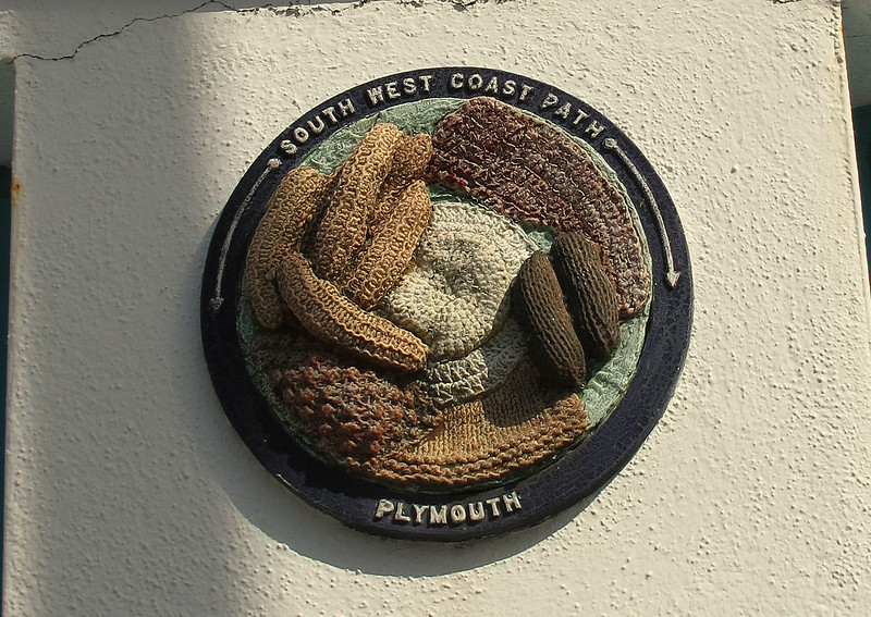 There are several of these knitted plaques on the coast path through Plymouth.