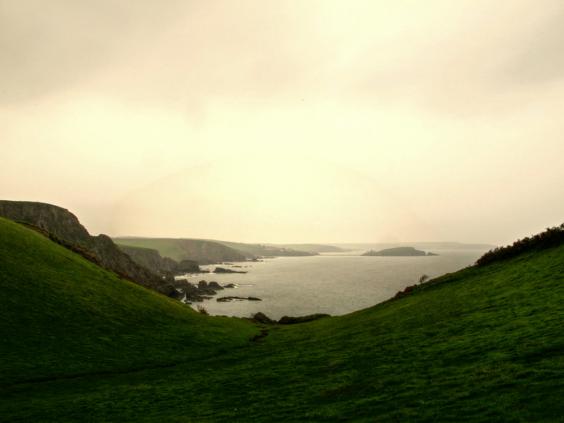 Near the end of a long walk, Challaborough is almost in sight through the steady rain.
