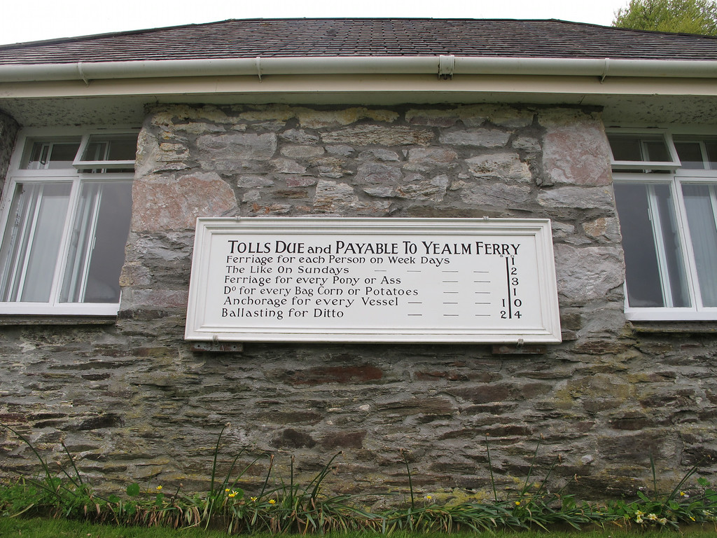 The old ferry house at Noss Mayo showing the ferry charges in force in previous times.