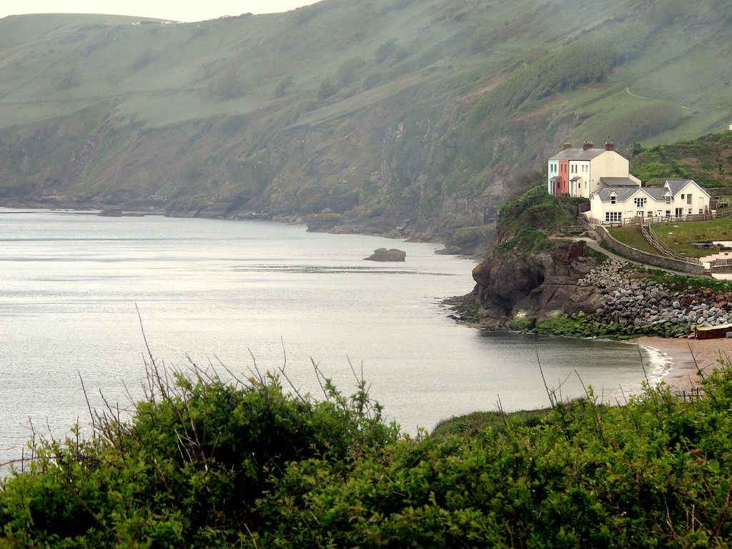 Remains of the lost village of Hallsands still visible beyond the modern houses.