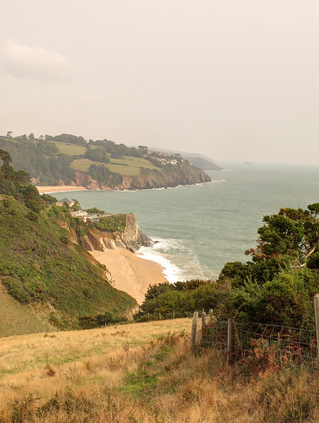 Landcombe Cove with Blackpool Sands  beyond.