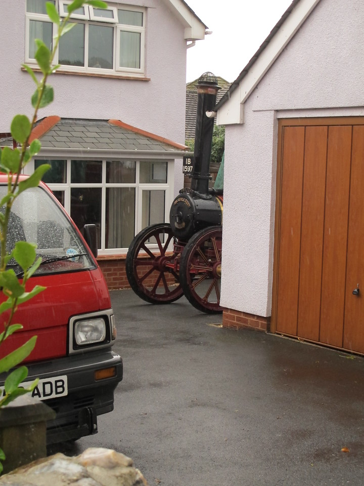 What is that lurking behind the garage?   No, it's a traction engine.