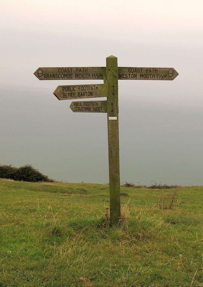 The signpost at Berry Camp, an ironage hill fort only half of which remains due to erosion.