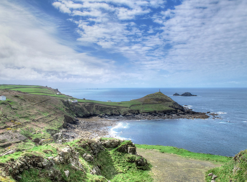 The headland in the middle of the picture is Cape Cornwall, once believed to be the most Western headland in mainland Britain.   Later when cartographers were more accurate it was found that Land's End held that distinction.   The group of rocks off Land's End which culminate in The Longships Lighthouse can be seen in the distance, to be passed tomorrow.