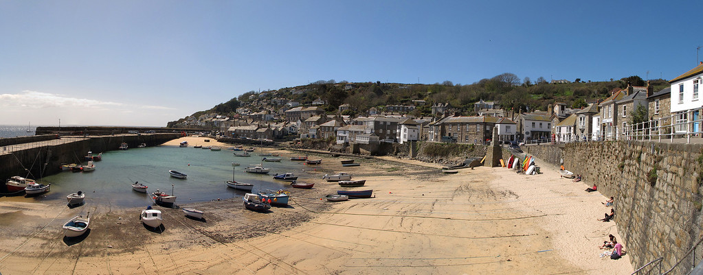 Time for morning coffee break and a sunny seat above the archetypical Mousehole harbour in warm sunshine.