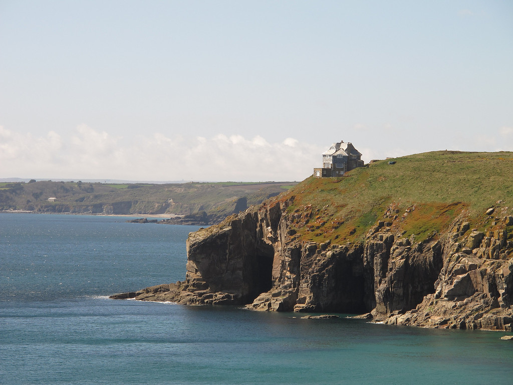 A large house perched precariously on the clifftop at Rinsey head.