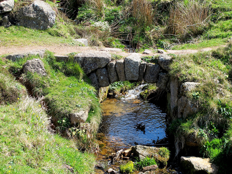 An old bridge probably built for miners to reach their workplaces along the rocky coastal paths.