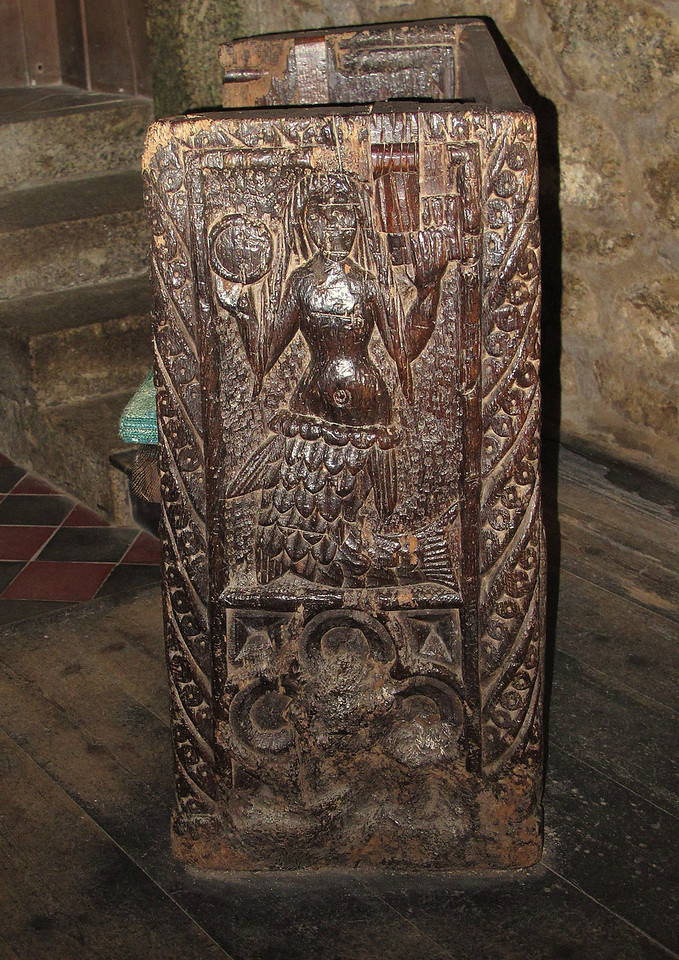 A pew end in the church illustrating the voluptuous form of the famous Zennor Mermaid (well, famous in Zennor!) who was said to have lured their star chorister out to sea.   Their voices can still be heard singing together under the sea during storms!