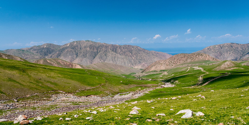 The Naryn - Tosor road approaches Issyk Kul which can just be seen between the mountains