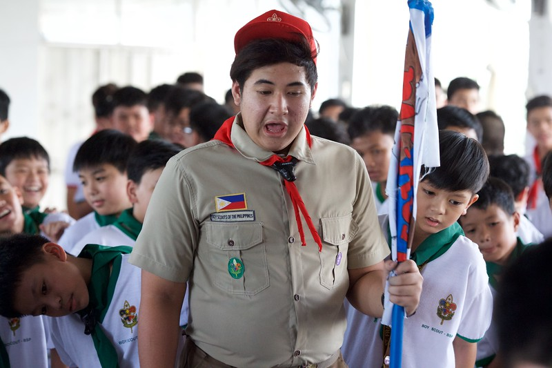 After a gruelling morning of physical activities, the scouts are given a chance to rest while listening and participating in a skill building lecture. Fundamental skills of scouting such as basic first aid, knot tying, and how to handle the Philippine flag are taught and practiced during this session.