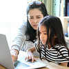 The,Asian,Woman,Teaching,Her,Child,To,Use,Computer.