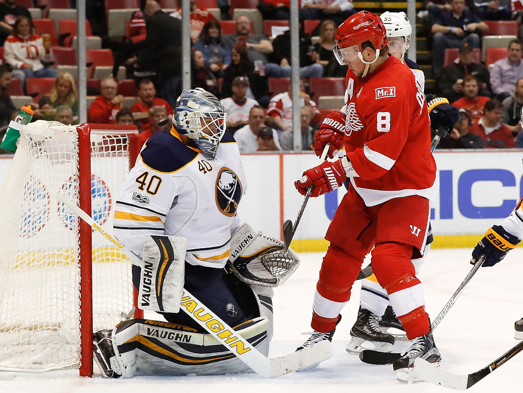 . Buffalo Sabres goalie Robin Lehner (40) stops a shot as Detroit Red Wings left wing Justin Abdelkader (8) waits for a rebound in the second period of an NHL hockey game Monday, March 20, 2017, in Detroit. (AP Photo/Paul Sancya)
