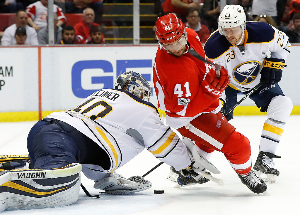 . Buffalo Sabres goalie Robin Lehner (40) stops a shot as Detroit Red Wings center Luke Glendening (41) tries for a rebound in the second period of an NHL hockey game Monday, March 20, 2017, in Detroit. (AP Photo/Paul Sancya)