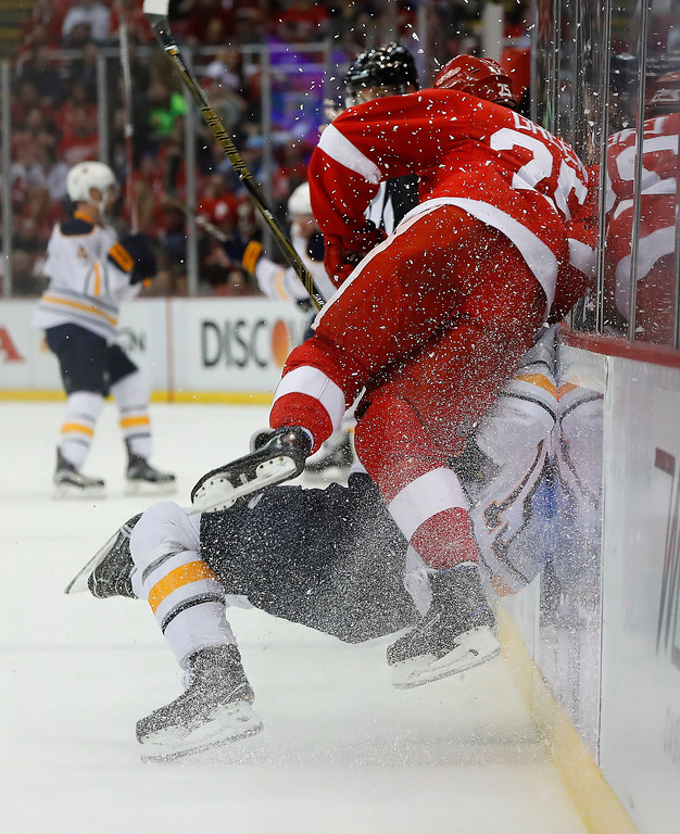 . Detroit Red Wings\' Mike Green checks Buffalo Sabres\' Jack Eichel into the boards in the first period of an NHL hockey game Monday, March 20, 2017, in Detroit. (AP Photo/Paul Sancya)