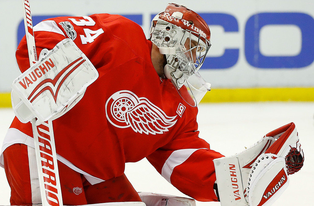 . Detroit Red Wings goalie Petr Mrazek (34) stops a Buffalo Sabres shot in the first period of an NHL hockey game Monday, March 20, 2017, in Detroit. (AP Photo/Paul Sancya)