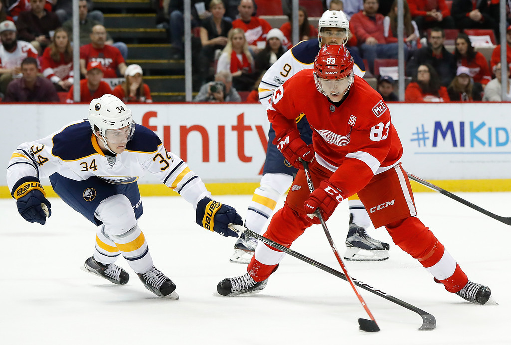 . Detroit Red Wings left wing Tomas Nosek (83) shoots as Buffalo Sabres\' Casey Nelson (34) defends in the second period of an NHL hockey game Monday, March 20, 2017, in Detroit. (AP Photo/Paul Sancya)