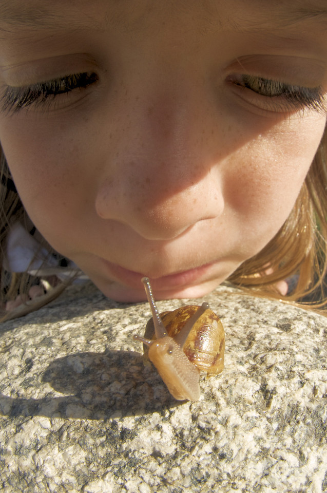 Mia and the Snail<br /> by Marc Roth<br /> <br /> 10.5mm fisheye. crop and color<br /> adjustment in Aperture and Capture NX.
