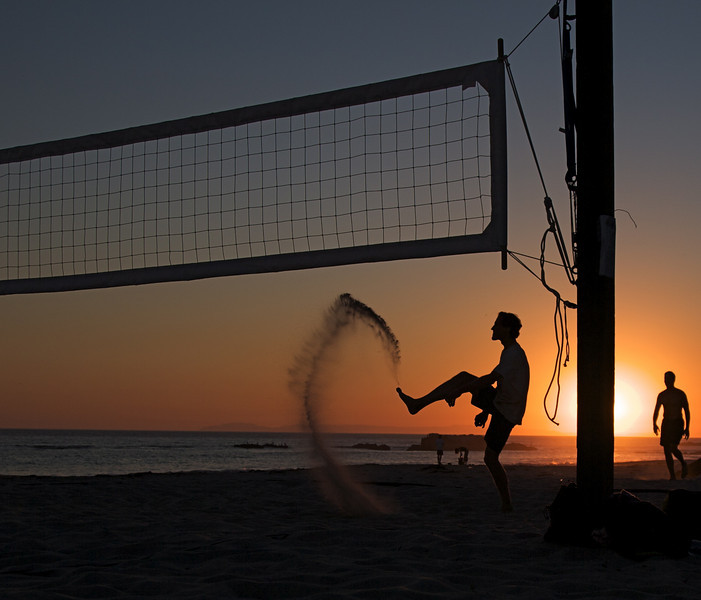 Volleyball Frustration<br /> By Judy Van Evera<br /> <br /> Notes:<br /> This was taken down at Main Beach in Laguna. When the ball went way out, the player became frustrated and kicked the sand. I wanted the picture to be a silhouette so I waited until the sun was very low.