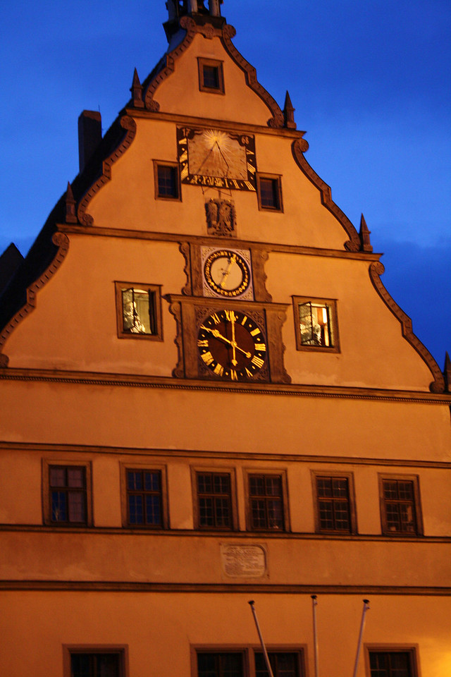 """Night Falls on """"The Master Drought""""<br /> By Denise Middleton<br /> <br /> Note: A Town Hall in Rothenburg Ob Der Tauber (Germany).  As the night falls a re enactment of a town citizen (Mayor Nusch) who drinks a whole tankard in one drought to save the town destruction and death."""