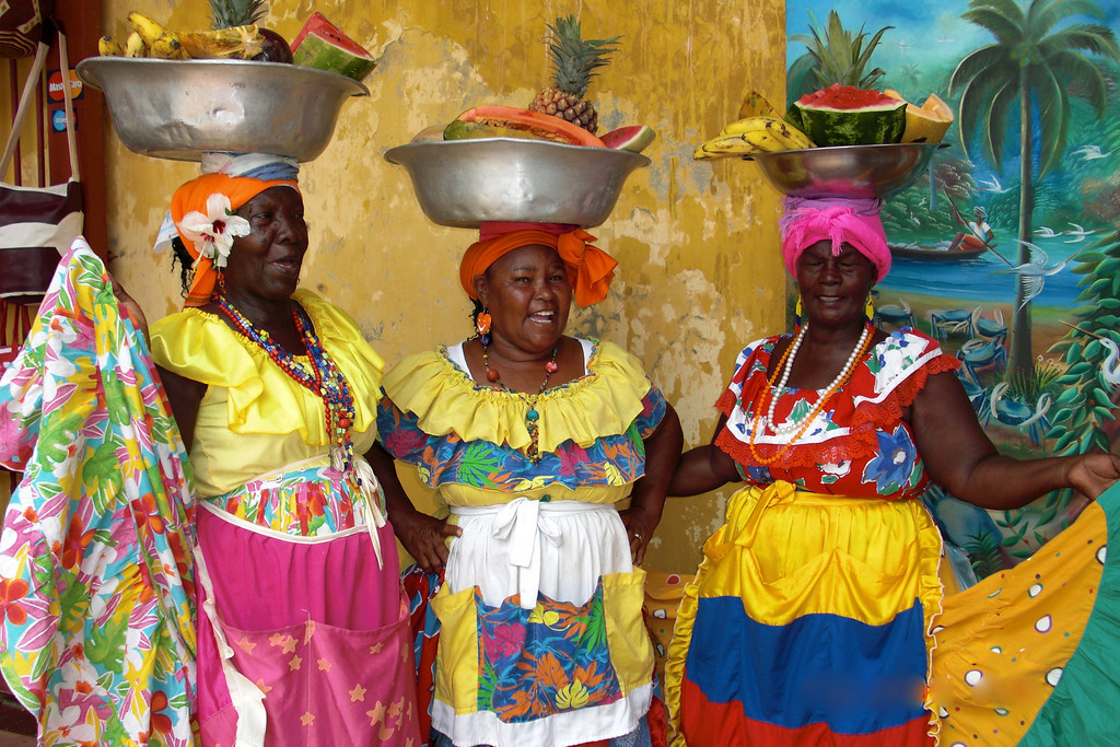 "Things in Threes<br /> By Carolina Schickler<br /> <br /> ""Las Palenqueras"" is the name given to these women from Cartagena, Colombia who sells tropical fruits. They're very famous for their colorful dresses and the way they carried the fruits"