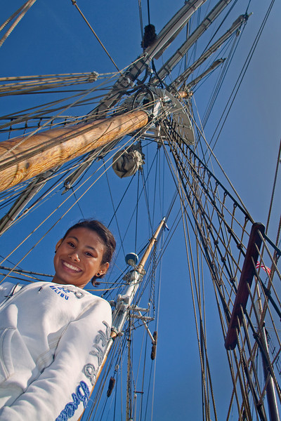 Smiling Shipmate<br /> By Claudia Tammen<br /> <br /> Notes:<br /> This friendly girl agreed to pose for me while I was lying on the deck taking photos of the rigging of one very Tall Ship at the Tall Ships Festival at Dana Point. Taken with my Canon 50D, f3.6, using on camera flash during daylight.
