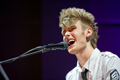 Colton Dixon, a contestant from American Idol, leads worship for Fuel on Sunday night at the Refinery.